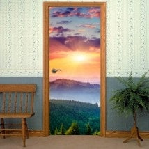 Decorative vinyl doors sunset in the mountains