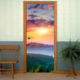 Decorative vinyl doors sunset in the mountains