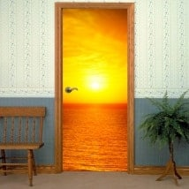 Decorative vinyl doors sea at sunset
